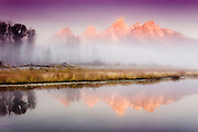 USA, Grand Teton National Park (WY).View of the Teton Range (13770 ft/4198 mt) from Schwabacher Landing on a foggy day at dawn