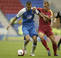 Photo: Aidan Ellis.<br /> Wigan Athletic v Reading. The Barclays Premiership. 26/08/2006.<br /> Wigan's Paul Scharner (L) holds of Reading's Steve Sidwell