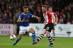 Jake Taylor of Exeter City passes under pressure from James Bailey of Carlisle United - Mandatory by-line: Gary Day/JMP - 18/05/2017 - FOOTBALL - St James Park - Exeter, England - Exeter City v Carlisle United - Sky Bet League Two Play-off Semi-Final 2nd Leg