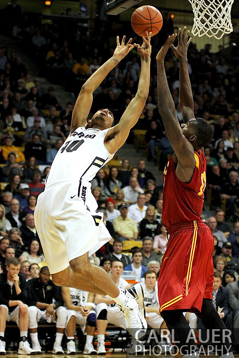 January 10th, 2013: Colorado Buffaloes freshman forward Josh Scott (40) is fouled on his shot attempt by University of Southern California Trojans junior forward Dewayne Dedmon (14) during the NCAA basketball game between the University of Southern California Trojans and the University of Colorado Buffaloes at the Coors Events Center in Boulder CO