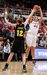 March 22, 2010; Stanford, CA, USA; Stanford Cardinal forward Joslyn Tinkle (44) shoots over Iowa Hawkeyes center Morgan Johnson (12) during the second half in the second round of the 2010 NCAA womens basketball tournament at Maples Pavilion. Stanford defeated Iowa 96-67.