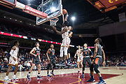 Pepperdine Waves forward Kessler Edwards (15) block a dunk attempt against Southern California Trojans forward Onyeka Okongwu (21) during an NCAA college basketball game, Tuesday, Nov. 19, 2019, in Los Angeles. USC defeated Pepperdine 91-84. (Jon Endow/Image of Sport)