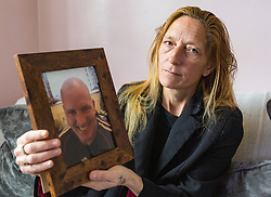 Lisa Lane, 49, holds the only picture she has of her late partner Scott Wilkinson, a dedicated pike fisherman, who was murdered by teenage brothers Shane Crawt, 19, and Lenny Crawt, 18, on Donkey Island at Walton-On-Thames in Surrey. Walton-On-Thames, Surrey, March 15 2019.