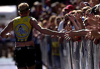 JEROME A. POLLOS/Press..Tom Lamphier, of Coeur d'Alene, is welcomed to the finish line.