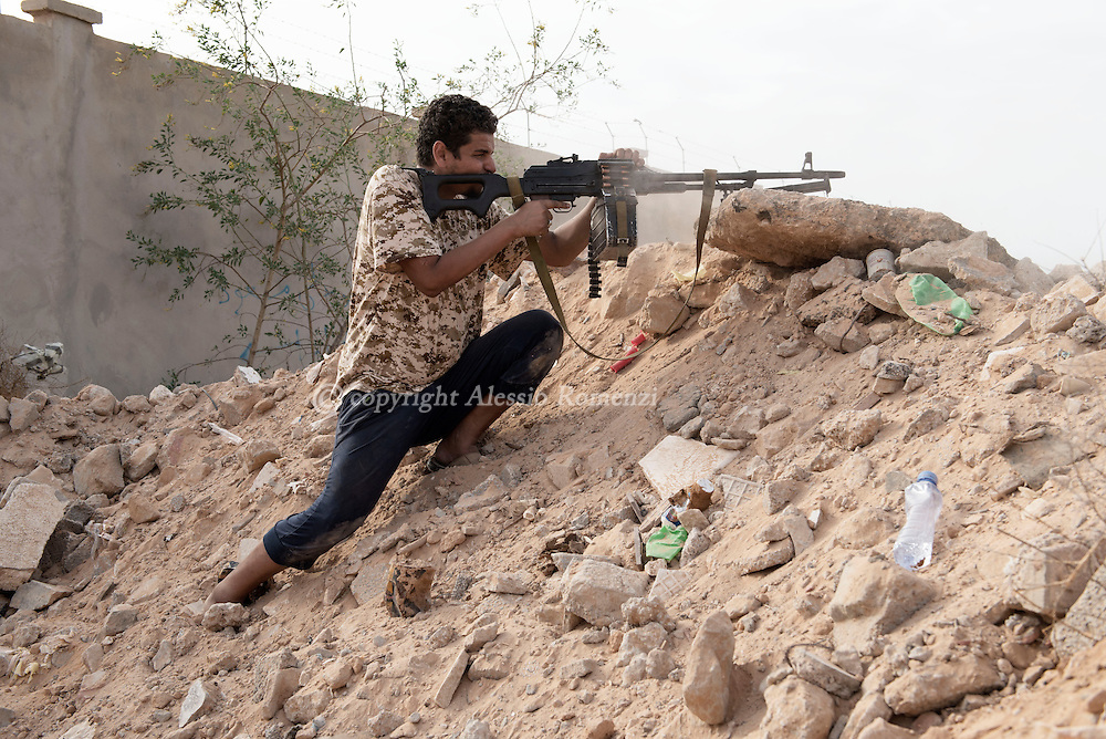 Libya: a fighter affiliated with Libya's Government of National Accord's (GNA) shoot at ISIS position in southern Sirte. Alessio Romenzi