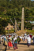 Women returning fom prayer walk in front of the Northern Stelae Park (Obelisk of Axum), Axum (Aksum), Ethiopia.