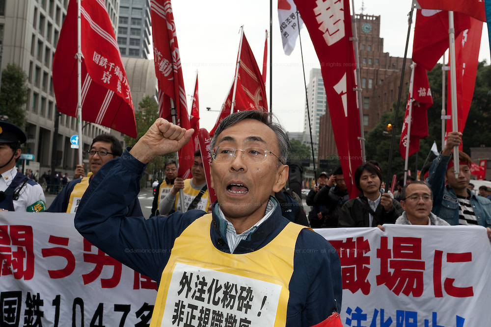 Yasahiro Tanaka the leader of the radical Doro Chiba railway union leads a demo march after a rally in Tokyo, Japan Sunday November 3rd 2013