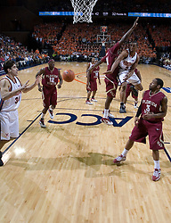 Virginia Cavaliers guard J.R. Reynolds (2) pass to teammate Virginia Cavaliers forward/center Ryan Pettinella (34).  The Virginia Cavaliers Men's Basketball Team defeated the Florida State Seminoles 73-70 at the John Paul Jones Arena in Charlottesville, VA on February 17, 2007.