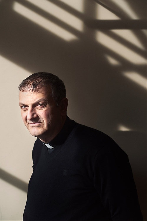 Paris, France. March 21, 2017. Father Jacques Mourad, from Syria, posing in a corridor at the Maison des Missions Etrangeres. Photo: Antoine Doyen