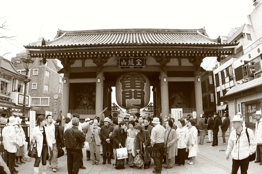 Mar 6, 2006; Tokyo, JPN; Asakusa.Visitors gather to take a group picture in front of the Kaminari-mon (Thunder gate) which marks the main entry way to the Senso-ji Buddhist temple...Photo credit: Darrell Miho
