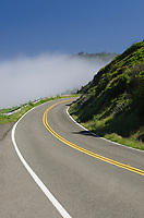 California Highway 1 winding its way along cliffs of Mendocino Coast