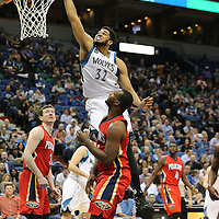 MINNEAPOLIS, MN - APRIL 13:  Karl-Anthony Towns #32 of the Minnesota Timberwolves dunks on Jordan Hamilton #25 of the New Orleans Pelicans in the second half on April 13, 2016 at Target Center in Minneapolis, Minnesota. (Photo by Adam Bettcher/Getty Images) *** LOCAL CAPTION *** Karl-Anthony Towns; Jordan Hamilton