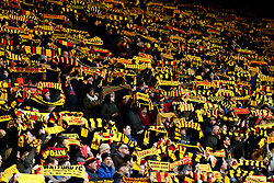 Watford fans show support for their team in the stands during the Premier League match at Vicarage Road, Watford.
