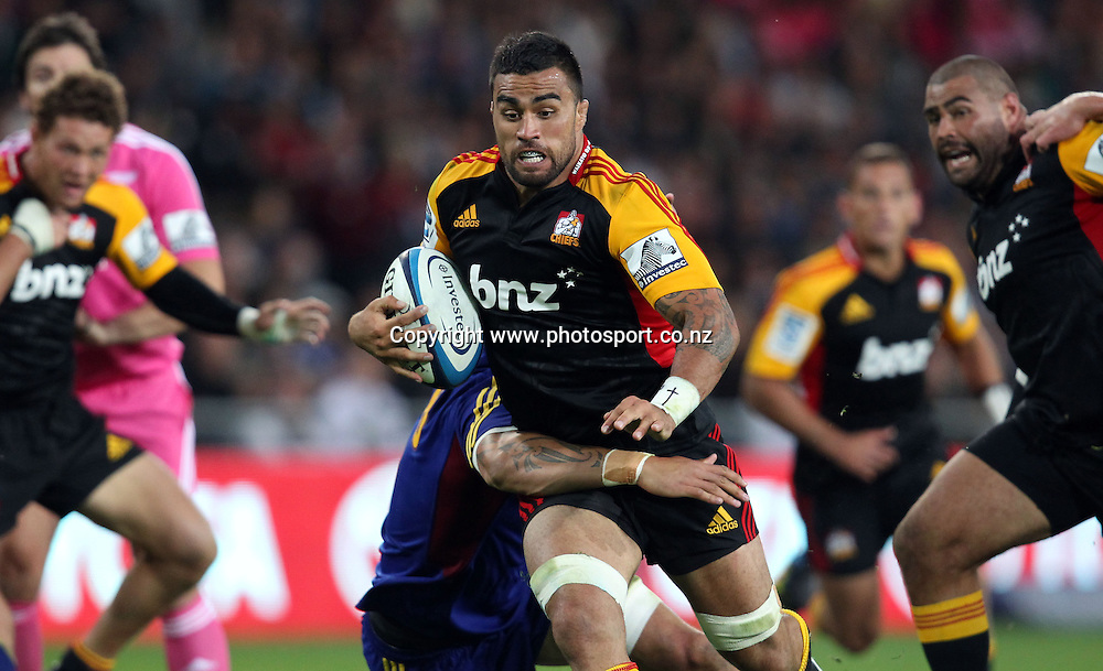 Liam Messam of the Chiefs busts the Highlanders defence.<br /> Super Rugby - Highlanders v Crusaders, 22 February 2013, Forsyth Barr Stadium, Dunedin, New Zealand.<br /> Photo: Rob Jefferies / photosport.co.nz