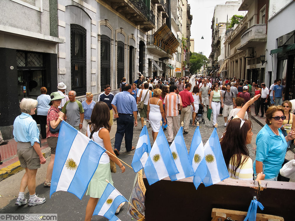 "Buy an Argentine flag and admire well-preserved old buildings at a street fair in San Telmo (""Saint Pedro González Telmo""), the oldest historic neighborhood (barrio) in the heart of Buenos Aires, Argentina, South America."