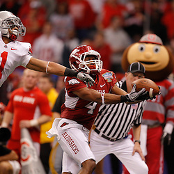 January 4, 2011; New Orleans, LA, USA;  Arkansas Razorbacks wide receiver Jarius Wright (4) catches a pass for a touchdown over Ohio State Buckeyes defensive back Devon Torrence (1) during the third quarter of the 2011 Sugar Bowl at the Louisiana Superdome.  Mandatory Credit: Derick E. Hingle