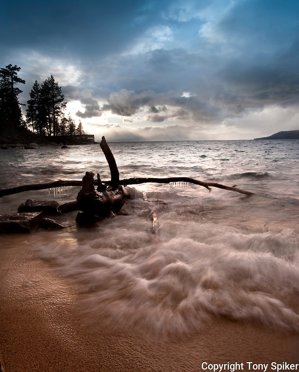 """Thunderbird Beach Sunset 1"" - The sun sets as a storm clears over a beach by Thunderbird Lodge, on the Eastern shore of Lake Tahoe"