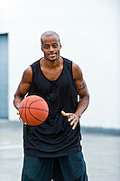 Young african american playing basketball in the street