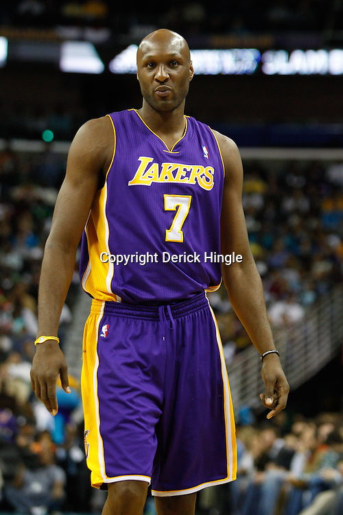 December 29, 2010; New Orleans, LA, USA; Los Angeles Lakers power forward Lamar Odom (7) against the New Orleans Hornets during the second half at the New Orleans Arena. The Lakers defeated the Hornets 103-88.  Mandatory Credit: Derick E. Hingle