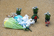 © Licensed to London News Pictures. 23/04/2014. New Malden, UK. Floral tributes and children's toys. The scene in New Malden where a woman has been arrested after the discovery of three bodies of children in a house overnight. Photo credit : Stephen Simpson/LNP