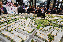 Model of new luxury housing estate at Akoya Park by developer Damac at property trade fair in Dubai United Arab Emirates