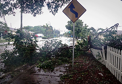 September 10, 2017 - Lake Worth, Florida, U.S. - A fallen tree limb blocks the sidewalk and part of Federal Highway as winds from Hurricane Irma begin to ramp up. (Credit Image: © Bruce R. Bennett/The Palm Beach Post via ZUMA Wire)