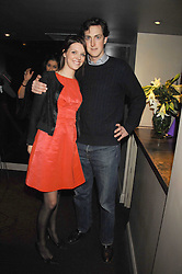 GENEVIEVE CHAPMAN and MARK CHISHOLM at a party to celebrate the 1st birthday of nightclub Kitts, 7-12 Sloane Square, London on 5th March 2008.<br /><br />NON EXCLUSIVE - WORLD RIGHTS