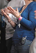 A rosary hangs from the hand of a woman attending the Wisconsin Catholic Youth Rally held March 24 at Mount Mary College in Milwaukee. (Photo by Sam Lucero)