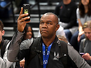 Mar 5, 2017; Albuquerque, NM, USA; Randall Cunningham videotapes his daughter Vashti Cunningham (not pictured) in the women's high jump during the USA Indoor Championships at the Albuquerque Convention Center.