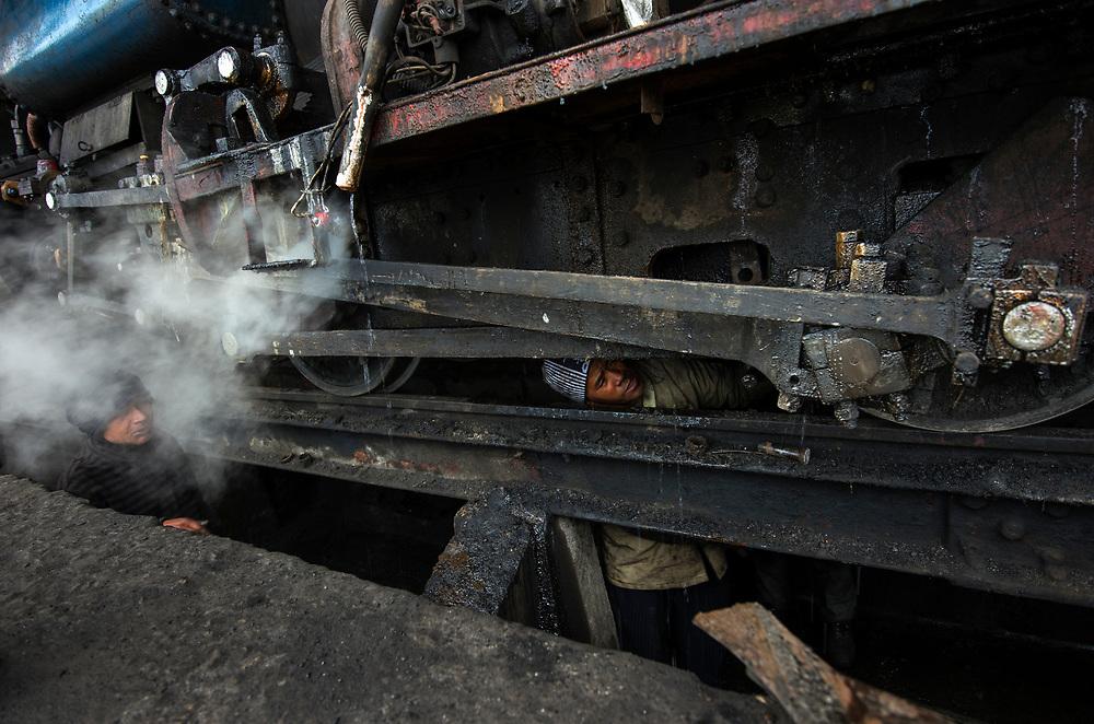 "Servicing steam engines of the DHR - Darjeeling Himalayan Railway - or ""Toy Train"", Darjeeling."