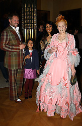 Left to right, JOE CORRE son of Vivienne Westwood, his wife SERENA REES their daughter CORA and VIVIENNE WESTWOOD at a reception to open an exhibition entitled 'Boucher Seductive Visions' at The Wallace Collection, Manchester Square, London W1 on 29th September 2004.NON EXCLUSIVE - WORLD RIGHTS