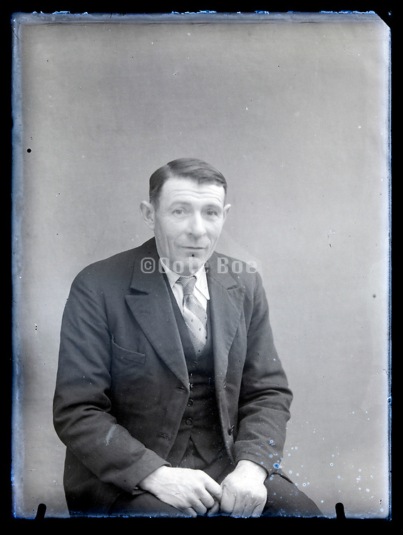 vintage portrait of an elderly man in suit France, circa 1930s