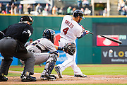 CLEVELAND, OH - SEPTEMBER 13: Home plate umpire Dana DeMuth #32 and catcher Alex Avila #13 of the Detroit Tigers watch as Mike Aviles #4 of the Cleveland Indians hits a single during the first inning during game two of a double header at Progressive Field on September 13, 2015 in Cleveland, Ohio. This game makes up a rainout on Friday, Sept. 11, 2015. (Photo by Jason Miller/Getty Images)  *** Local Caption *** Dana DeMuth; Alex Avila; Mike Aviles