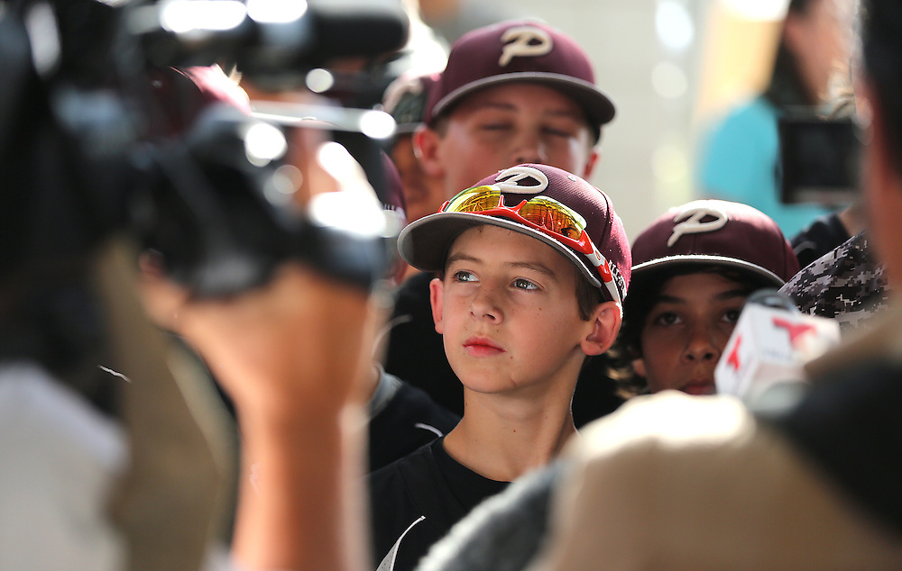 8/8/14: Presley Smith,(LF) looks around in wonder ,as the press surrounds the little league Pearland baseball team at the Pearland Little League send off fundraise party at the RIG in Pearland, TX. (Photo by Thomas B. Shea for the Houston Chronicle).