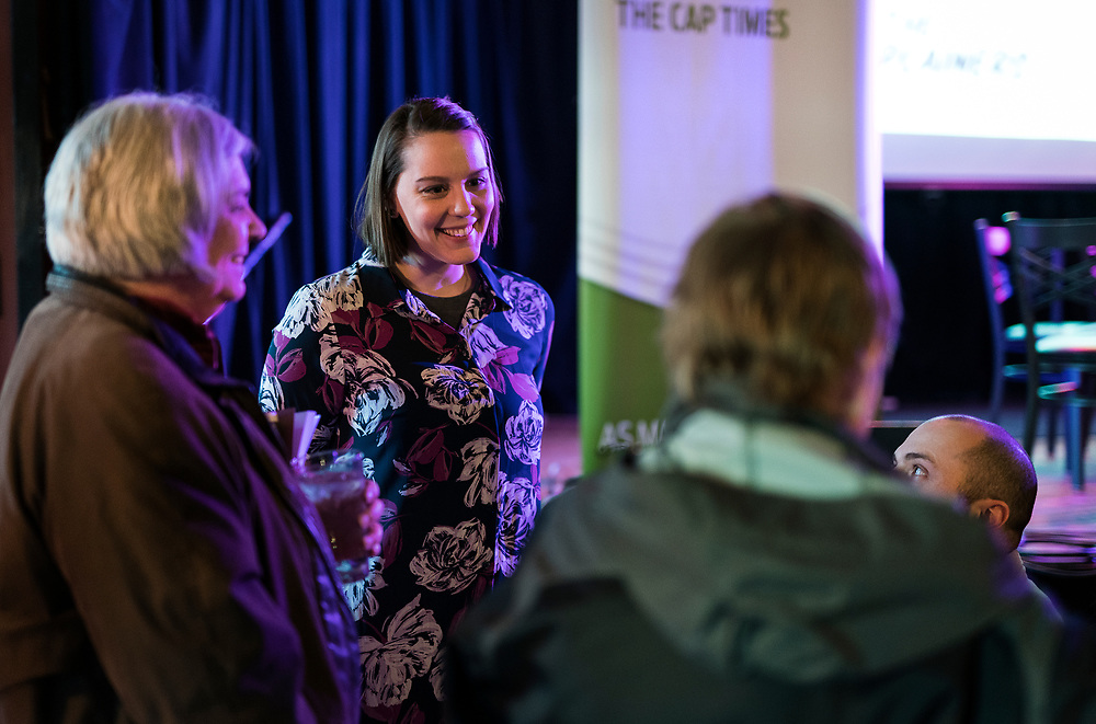"Abigail Becker speaks with attendees before the live taping of the ""Madsplainers"" Podcast at High Noon Saloon in Madison, WI on Tuesday, April 9, 2019."