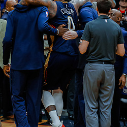 Jan 26, 2018; New Orleans, LA, USA; New Orleans Pelicans center DeMarcus Cousins (0) is assisted off the court after sustaining an injury during the fourth quarter against the Houston Rockets at the Smoothie King Center. Pelicans defeated the Rockets 115-113. Mandatory Credit: Derick E. Hingle-USA TODAY Sports