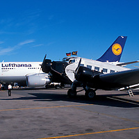 Lufthansa aircraft - an old Junkers JU52 stands next to a modern Lufthansa Airbus at Washington National Airport.