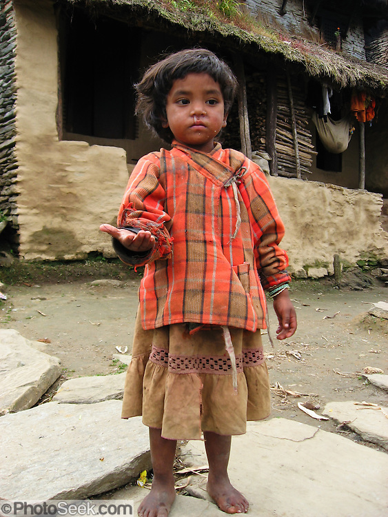 A girl asks for a handout in Nepal, Asia.