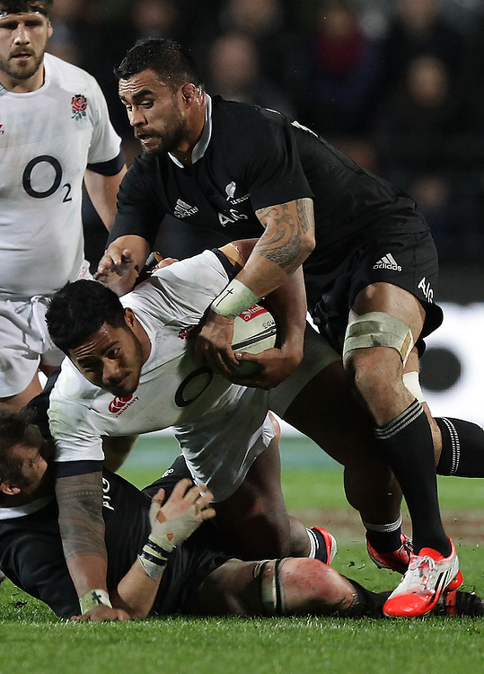 New Zealand's Liam Messam tackles England's Manu Tuilagi in an International Rugby Test match, Waikato Stadium, Hamilton, New Zealand, Saturday, June 21, 2014.  Credit:SNPA / David Rowland