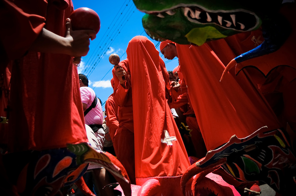Venezuelans celebrate the Festival de los Diablos Danzantes (Dancing Devils) in San Francisco de Yare, Venezuela on June 11, 2009. The festival has been held annually since 1742, and is famous for being one of Venezuela's most important and most colorful cultural events. To celebrate, thousands of Venezuelans clad in red devil costumes and brightly painted papier-mache masks take to the streets dancing to the rhythm of drumbeats and maracas. The festival, always held on Corpus Christi (the 60th day after Easter) manifests the struggle between good and evil, after spending hours dancing, the devils kneel in front of the historic Church of San Francisco, and a local catholic bishop blesses them, signifying the devils' submission and the triumph of good.  Locals also believe the ritual brings them prosperity and protection from misfortune.