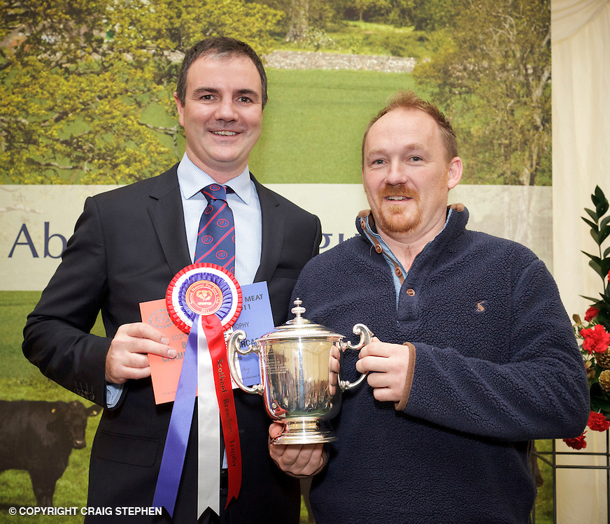Scottish National Premier Meat Exhibition & competition to promote Scottish livestock from farm to consumer, sponsored by Marks & Spencer. Held at Scotbeef Ltd, Bridge of Allan, Saturday 19th Novermber, 2011..Malcolm Copland, head of trading at Marks & Spencer presents ? TW Hutchison, Bail Hill, Co Durham - Scotbeef Breeders Trophy