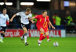 Wales David Vaughan (Sunderland) battles for the ball with Scotland's Darren Fletcher (Manchester United) - Photo mandatory by-line: Joe Meredith/JMP  - Tel: Mobile:07966 386802 12/10/2012 - Wales v Scotland - SPORT - FOOTBALL - World Cup Qualifier -  Cardiff   - Cardiff City Stadium -