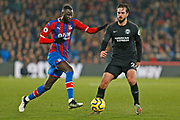 Cheikhou Kouyate and Davy Propper in action during the Premier League match between Crystal Palace and Brighton and Hove Albion at Selhurst Park, London, England on 16 December 2019.