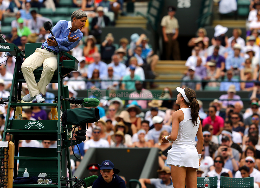 Johanna Konta speaks to umpire Marija Cicak during her match against Caroline Garcia on day seven of the Wimbledon Championships at The All England Lawn Tennis and Croquet Club, Wimbledon.