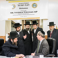 London, UK - 3 December 2014: Mr Stephen Williams MP, Parliamentary Under Secretary of State for Communities and Local Government, speaks to teachers as he  visits the Talmud-Torah Yetev-Lev orthodox Jewish school in Hackney, London