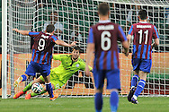 Christy Fagan of St Patrick's (L) shoots goal for his team next to Legia's goalkeeper Dusan Kuciak (C) during Second qualifying round UEFA Champions League soccer match between Legia Warsaw and St. Patrick's Athletic at Pepsi Arena in Warsaw, Poland.<br /> <br /> Poland, Warsaw, July 16, 2014<br /> <br /> Picture also available in RAW (NEF) or TIFF format on special request.<br /> <br /> For editorial use only. Any commercial or promotional use requires permission.<br /> <br /> Mandatory credit:<br /> Photo by © Adam Nurkiewicz / Mediasport