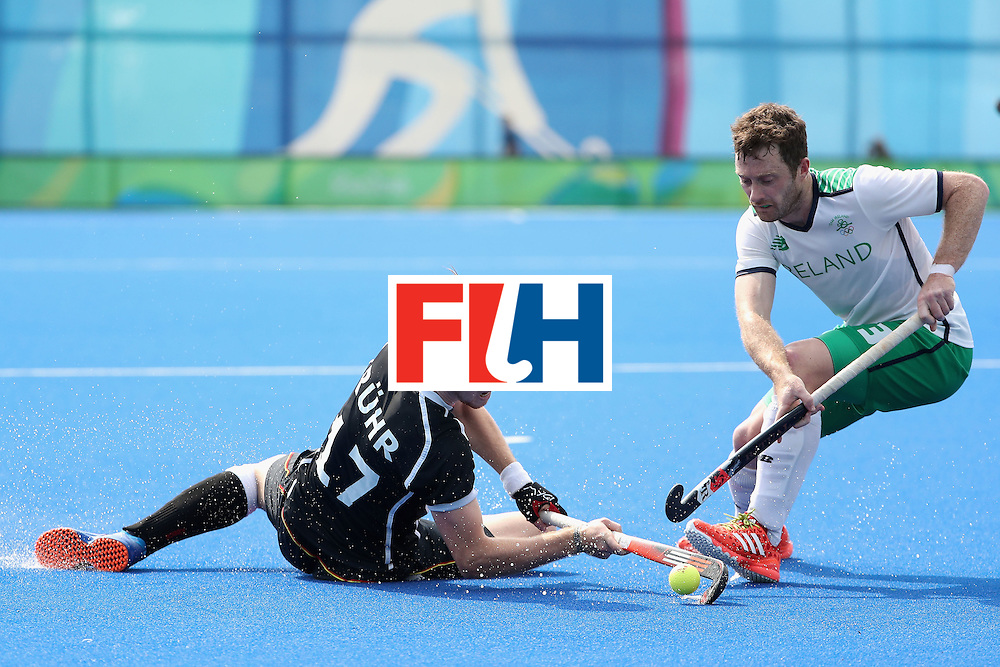 RIO DE JANEIRO, BRAZIL - AUGUST 09:  Christopher Ruhr #17 of Germany loses the ball to John Jackson #3 of Ireland during the hockey game on Day 4 of the Rio 2016 Olympic Games at the Olympic Hockey Centre on August 9, 2016 in Rio de Janeiro, Brazil.  (Photo by Christian Petersen/Getty Images)