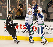 Kevin Bieksa (3) of the Vancouver Canucks is congratulated by teammate Mason Raymond (21) after scoring a goal against the Dallas Stars Thursday, February 21, 2013 at the American Airlines Center in Dallas, Texas. (Cooper Neill/The Dallas Morning News)