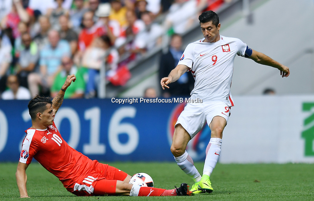 2016.06.25 Saint-Etienne<br /> Pilka nozna Euro 2016<br /> mecz 1/8 finalu Szwajcaria - Polska<br /> N/z Granit Xhaka Robert Lewandowski<br /> Foto Lukasz Laskowski / PressFocus<br /> <br /> 2016.06.25<br /> Football UEFA Euro 2016 <br /> Round of 16 game between Switzerland and Poland<br /> Granit Xhaka Robert Lewandowski<br /> Credit: Lukasz Laskowski / PressFocus