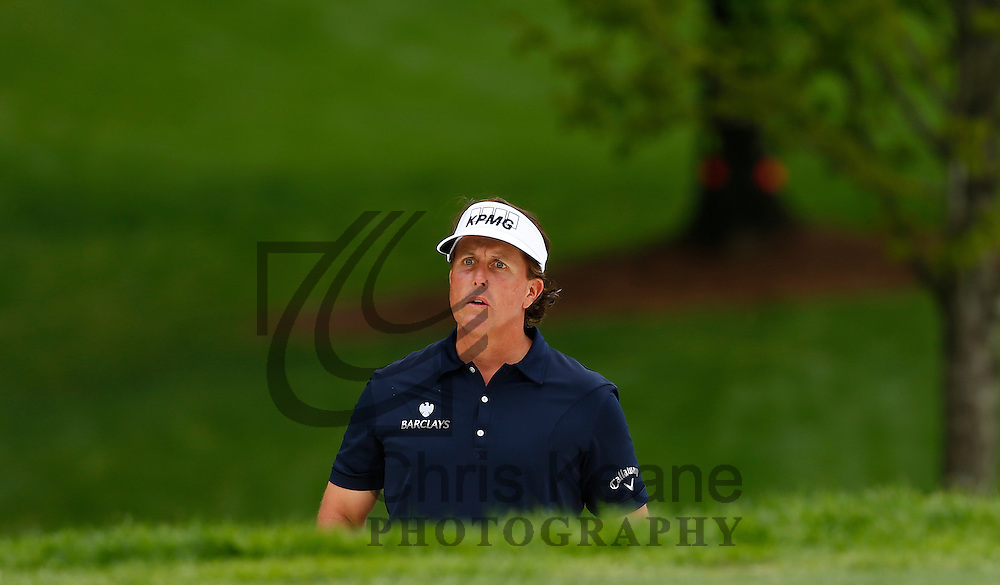 Phil Mickelson of the U.S. plays his third shot on the eight hole from the greenside bunker during the second round of the Wells Fargo Championship at the Quail Hollow Club in Charlotte, North Carolina on May 3, 2013.  (Photo by Chris Keane - www.chriskeane.com)